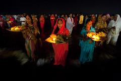 Until crack of the dawn (Ashish T) Tags: ocean sea woman sun india men colors festival night canon lowlight women worship colorful indian religion tokina celebrations ritual mumbai hindu hinduism puja prayers 1224 chhath 40d socialaffairs ashishtibrewal
