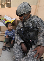 Playground talk (The U.S. Army) Tags: school boy soldier army child military iraq backpack mission iraqi oif combatcamera humanitarianaid northerniraq 1stcavalrydivision 3rdbrigade ninewaprovince alfa2ndofthe82ndfieldartillery samsonbarini 422ndcivilaffairsbattilion miaravillage