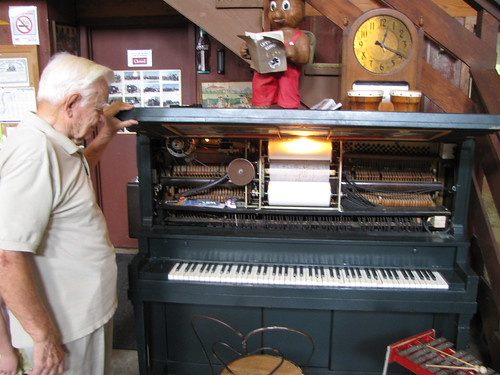 Museum founder with player piano
