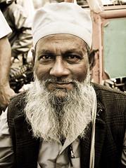 The Graceful (Jogeshwar) Tags: road street portrait india man senior smile lens nikon busy human desaturated 1855 nikkor graceful kolkata calcutta gracious jogeshwar d3000 nikond3000