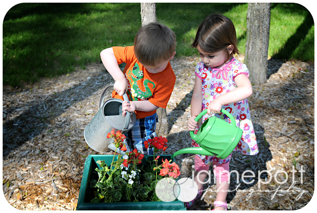 Ethan and Ella watering the flowers