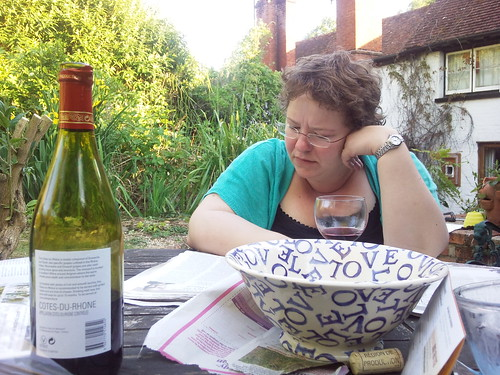 Moo, reading the paper, drinking wine