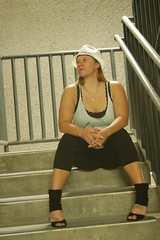Solitude (Fearless Photoworks) Tags: white black sexy beautiful night stairs outside amazon women parkinglot punk pretty industrial sitting highheels parkinggarage gorgeous cement longhair tall fedora railing leggings tanktops overheadlighting