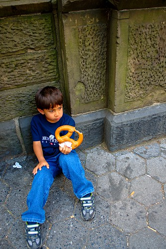 nyc kid eating pretzel