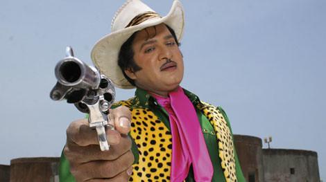 Rajendra Prasad pointing a gun