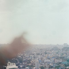 (Syka Lê Vy) Tags: city sky film 35mm landscape hand air vietnam vy dreamer 2009 sleepwalker lê canonql17 touchthesky syka vắng fromsykawithlove sykalevy lehoangvy sundayspirit
