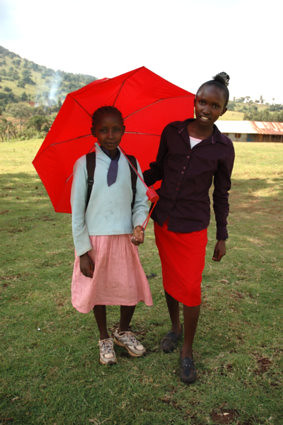 """Kakenyas two younger sisters with Maasai traditional red color, """"doudou""""(means little in Maasai) and Nashibai."""