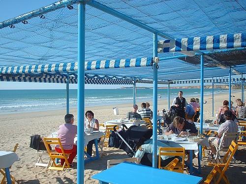 Terraza con la Playa de la Fontanilla al fondo