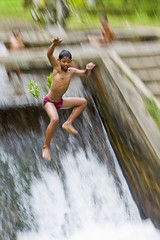 Water Fun Series - How do you find my panning ? (Mio Cade) Tags: travel boy shirtless bali kids swim indonesia fun photography waterfall kid asia afternoon village child play leo expression joy running southeast panning slippery slope rushing abangan