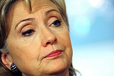 They are between Hillary's Black Earring and the Bump on Her Lip!