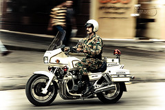 The Fast & The Furious! (SonOfJordan) Tags: street old city people motion blur festival century speed canon honda army eos centennial movement downtown bokeh cityhall flag helmet amman police security parade jordan motorbike motorcycle theme 100 colourful xsi gam   450d   samawi  sonofjordan shadisamawi  wwwshadisamawicom