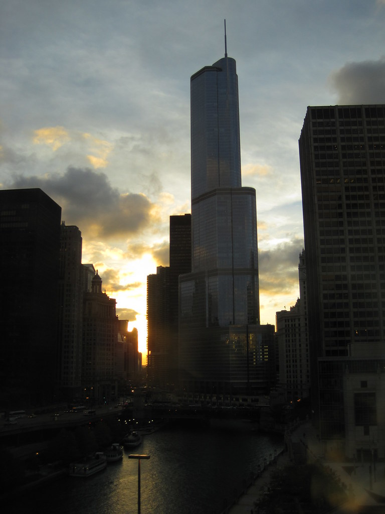 Trump, on the Chicago river at dusk