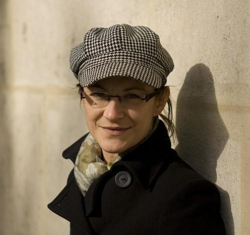 light shadow paris france hat wall standing scarf walking glasses coat leaning ewa 2470