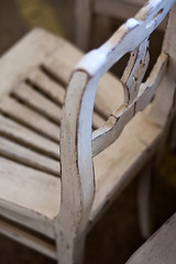 Simple antique wooden chair painted white