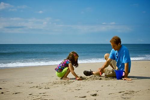 Building sand castles.