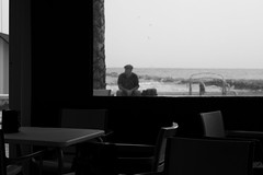 a man waiting behind the plastic window (pepe amestoy) Tags: blackandwhite streetphotography people elcampello spain fujifilm xe1 carl zeiss t planar 250 zm leica m mount planart250