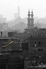 Fly high! / Le wysoko! (ania.egypt) Tags: city travel roof boy blackandwhite bw holiday kite tower buildings minaret egypt cairo dach wakacje miasto egipt selectedcolor cairotower budynki wiea czarnobiae podr kair latawiec chopiec babzuweila chopcy selectedcolour imagesofharmony