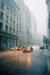 Saturday Afternoon Thunder Storm (Gigantic Robot) Tags: street storm rain montreal portra 800 nikonfm2 lotsofrain nikkor28mm giganticrobot citysummerrainanalogkodak