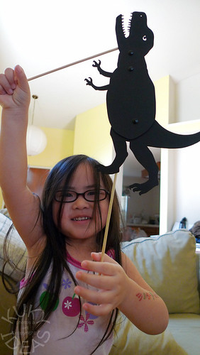 Playing with her Owly Shadow Puppet