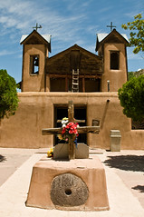 Santuario de Chimayo (idashum) Tags: travel newmexico flower tower church nikon worship shrine catholic power cross miracle religion explore dirt powers healing legend pilgrimage sanctuary romancatholic chimayo heal goodfriday d300 nationalhistoriclandmark santuariodechimayo 1816 explored healingpower