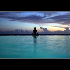 Meditation (JannaPham) Tags: ocean trip travel blue light sunset sea holiday reflection water girl silhouette sunrise canon children relax island eos hotel peace resort vietnam harmony meditating 5d phuquoc calmness markii hbm project365 chenla happybluemonday jannapham
