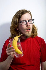 we're supposed to have how many pints of fruit a day? (Edward Moore as edshots) Tags: red portrait selfportrait me glass face yellow digital self canon hair studio beard person eos 50mm glasses geek flash banana sp 5d canon5d dslr pint whiteleaf pintglass squiddle comedyshots edmoore whiteleafstudios beardedgeek