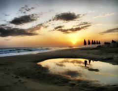 Sunrise in Rethymno, Crete (Theophilos) Tags: sea sky reflection beach clouds sunrise landscape east greece crete umbrellas rethymno