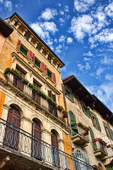 Architecture, Verona, Italy (sminky_pinky100 (In and Out)) Tags: life city travel blue italy brown tourism yellow architecture clouds buildings europe details perspective angles verona shutters balconies tall colourful railings windowboxes personalbest 5photosaday bej abigfave omot eyejewel paololivornosfriends