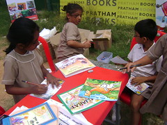 Kids making their own little reading corner