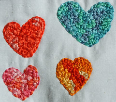 Embroidered, multicolored hearts