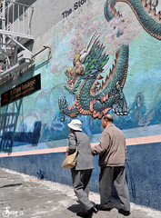 Stroll though Chinatown (AnotherSaru - Limited mode) Tags: sf sanfrancisco street blue woman man green art painting walking mural couple chinatown dragon hill chinese citylife bayarea streetshot elderlycouple