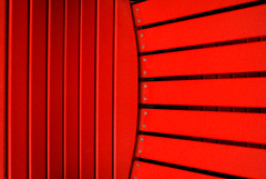 Red Rays Reaching Eastward (bkwdayton) Tags: red abstract lines vivid adirondackchair golddragon colorphotoaward theperfectphotographer thechallengefactory storybookwinner storybookbtd1st