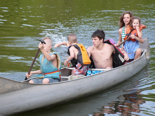 Rachel and Joel taking my children canoeing in the lake