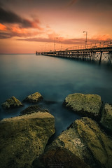Another World (Alex Apostolopoulos) Tags: longexposure sunset water clouds dock rocks seascape sea sky landscape pier cyprus sony sonya6000 ilce6000 samyang samyang12mmf20ncscs haidafilters manfrottobefree