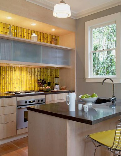 Modern yellow kitchen + Heath subway tiles + Bertoia barstools