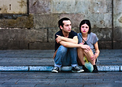 Private moment. In public. (skedonk) Tags: barcelona street portrait spain couple sad serious candid save8 sidewalk relationship 2009 esp breakup cataluna explored skedonk dellete10 explored5310996