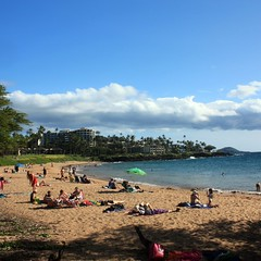 Beachgoers enjoying Ulua Beach on South Maui.