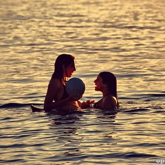 Sunset Play (Osvaldo_Zoom) Tags: girls sunset sea summer italy beach ball skinny gold play joy explore frontpage amicizia calabria 1930 dipping gioia messinastrait nikkor18200 littlestoriespicswithsoul