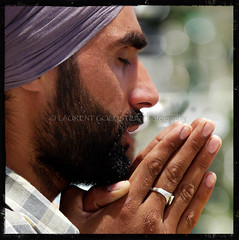 Drifting into a Flow of Faith (designldg) Tags: travel portrait people india man eye texture closeup square temple photography hands peace bokeh expression finger faith prayer religion handsome atmosphere panasonic fabric silence soul devotion turban sikh tradition punjab spiritual shanti amritsar sikhism contrejour goldentemple celestial  corporeal indiasong dmcfz18