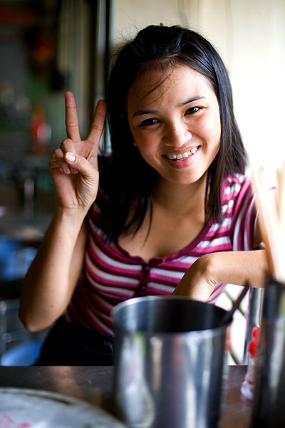 A friendly employee at Hong Hanh restaurant, Saigon, Vietnam