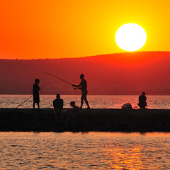 Akbk Sunset (christian.senger) Tags: travel light sunset red people sun water silhouette yellow digital turkey geotagged gold nikon asia outdoor polarizer frontpage angler d300 nikoncapturenx2 christiansenger:year=2009 gettyvacation2010