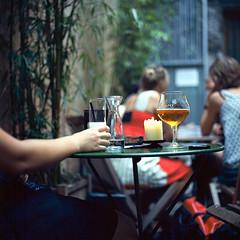 Berry 0107 (ukaaa) Tags: macro slr 120 6x6 film water beer caf closeup bar analog square table outside berry friend candle belgium kodak belgi bamboo medium mf analogue ghent gent canoscan terras cosy a12 pastis singlelensreflex celine ektar carlzeiss hasselblad500cm sekonic l308s 8800f hotclubdegand extensiontube21 straffehendrik ektar100 80mmf28planarct