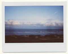 From a train... (AndyWilson) Tags: sea window lines clouds train polaroid fuji wide instant hastings stleonards instax bexhill instax100 ajwch