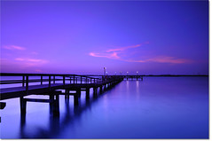 From Pier to Eternity (Jim | jld3 photography) Tags: ocean longexposure pink blue sunset sea evening bay coast pier twilight dock nikon texas dusk smooth filter bluehour 12mm vignette portaransas nightfall d300 leefilterholder charliespasturefishingpier