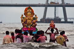 God places the heaviest burden on those who can carry its weight (Ashish T) Tags: ocean sea people india color festival ganesha colorful published god indian joy ceremony culture lord farewell ritual goodbye mumbai hindu hinduism emotions sorrow deity reuters visarjan ganpati immersion featured