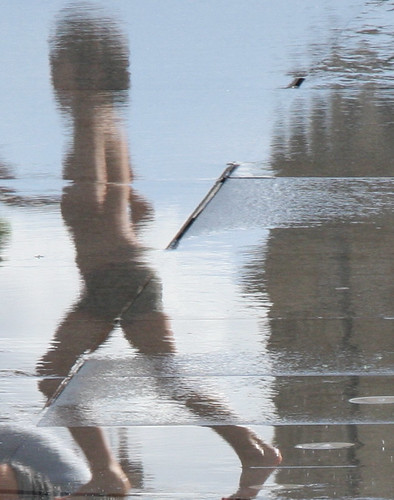 Kid playing Bordeaux reflection pool