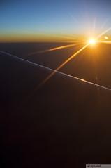 streaking sun! (recaptured) Tags: blue sky sun window yellow airplane golden nikon f14 horizon wing earlymorning aeroplane sleepy flare streaks recaptured 30mm d90 sigma30mmf14 onepointfour amitsharma recapturedin