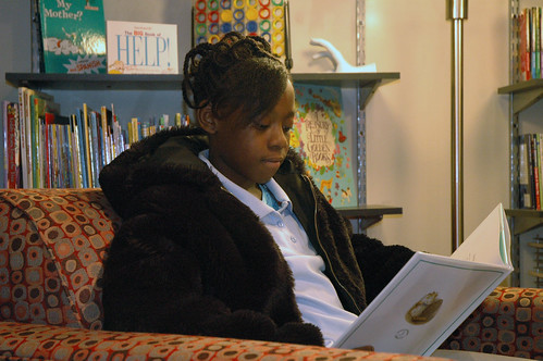 Alexis Shelton relaxes with a book at The Salvation Armys new Library / Media Center.
