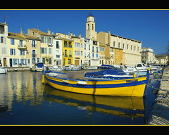 Martigues, Provence (dubus regis) Tags: city blue france reflection church yellow jaune alpes boats boat marseille village olympus bleu reflet e3 cote provence 1001nights bateau église reflets quai barque anneau barques dazur martigues 1260 anneaux pointu mygearandmepremium mygearandmebronze mygearandmesilver mygearandmegold mygearandmeplatinum