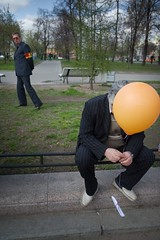 boring... (f_lynx) Tags: street city portrait people orange man color green fun russia moscow balloon 2x3 may1st flynx d700 afnikkor2814d oslo8 exhibitionoslo8basel2012